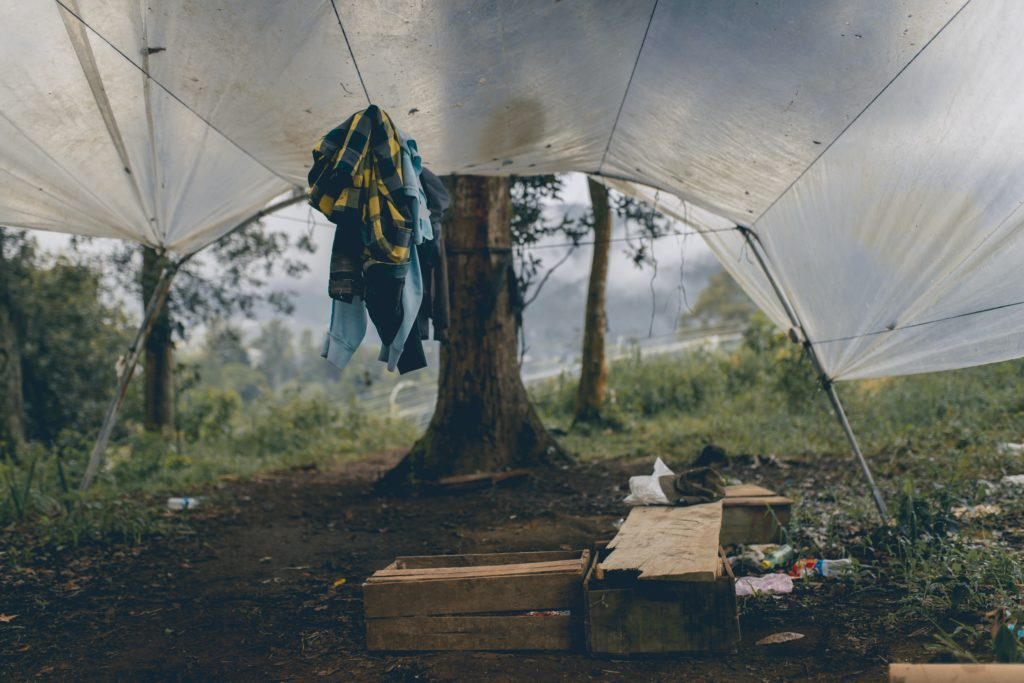 clothes hanging under white tent