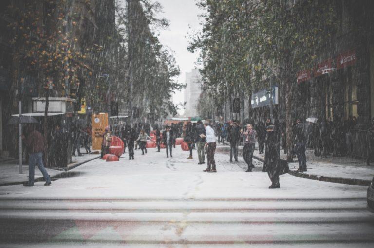 people walking on street during winter
